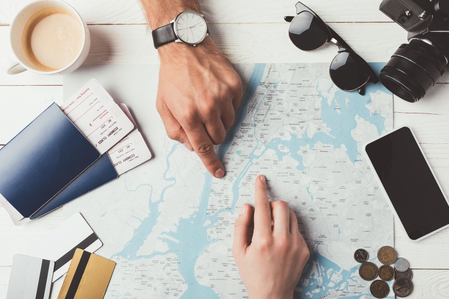 Hands pointing to a location on a map