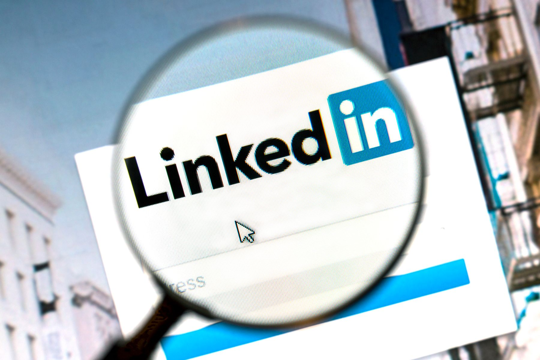 Magnifying glass showing Linkedin
