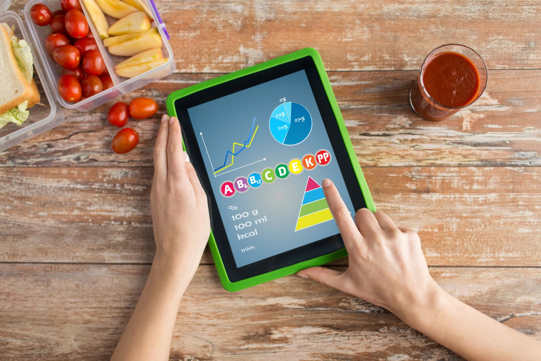 Reading about a food health app on tablet