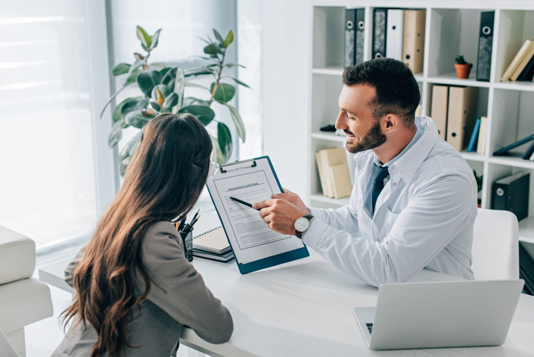 Doctor and patient talking about a form