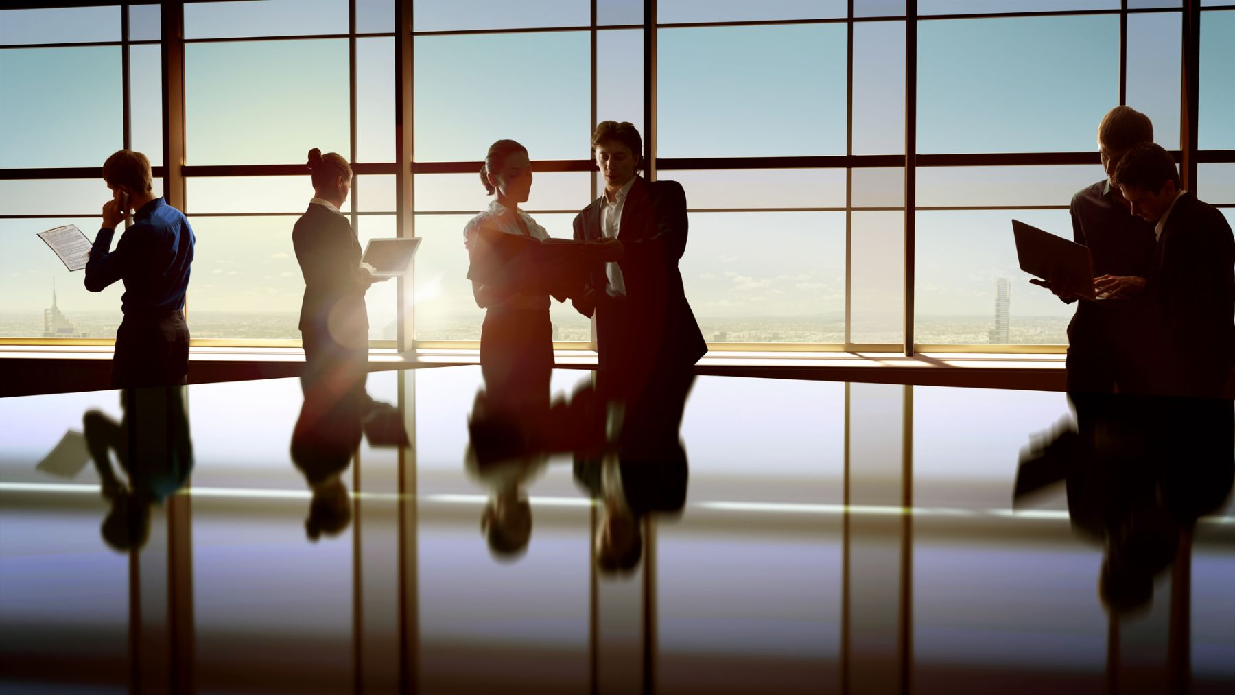 Business People talking around conference table